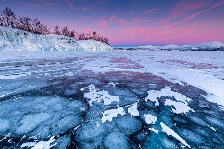 Sunrise on frozen lake